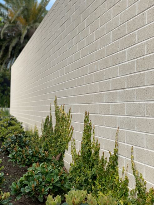 Brick fence in Newcastle with feature brickwork in a cream brick