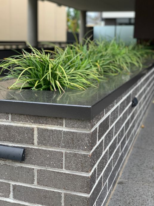 Planter Box in Newcastle laid by a bricklayer with feat brickwork